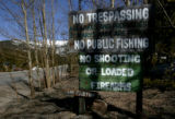 A sign on Fall River Road Tuesday April 23, 2008, expresses the frustration of locals protecting...