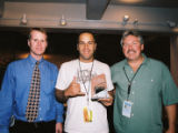 Left, Tad Bowman, operations manager for Red Rocks, singer/songwriter Jack Johnson, and Erik Dyce,...