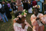 MJM137 Aubree Nave (cq), 7, center, and Agok Mabil (cq), 7, of Barrett Elementary School hold onto...