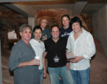 Left is promoter Chuck Morris, center is promoter Brent Fedrizzi, with the band, Big Head Todd and...
