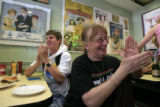 DM0106  Server Berta Godin and busser Jack Bigham applaud as Annie's Cafe owners Peggy Anderson,...