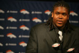Denver Broncos first round draft pick Ryan Clady (cq) an offensive tackle from Boise State takes...