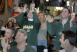 Greenbay Packer fans cheer as their team scores a TD as they watch the game at Swanky's Oysters...