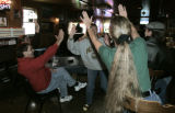(L-R) Pat Giesler (cq) center, gives a high five to Janis Brown (cq) after  the Packers scored a...