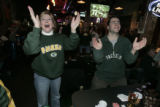Greenbay Packer fans(L-R)  Bernie Stadtmueller (cq) (a woman ) and her son John Stadtmueller Jr,...