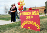 Donna Henkel and Don Rauh hug as they meet at the entrance to the Ponderosa High School 25th...