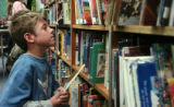 Darren Harder (cq) looks over books in the school library Monday morning October 10, 2005 at...