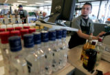 Matt Santistevan checks out a customer at Applejack Liquor  Store in Wheatridge  Monday April 14,...