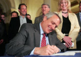 Gov. Ritter signs Senate Bill 82 (sponsored by Veiga/Jahn), Monday, April 14, 2008,  at the...