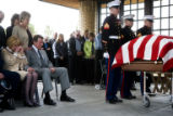 John and Mary Jane Vandegrift (cq) watch a military honorary guard begin to fold a flag drapped...