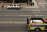 CODER106 A Monte Vista fire truck carrying the coffin of Srgt. Glen Martinez, 31, drives through...