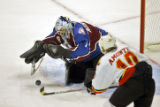 The Colorado Avalanche's David Aebischer (#1) pounces on a rebound in front of his net as the...