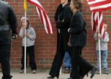 CODER105 Two boys hold American Flags as friends and family of Srgt. Glen Martinez, 31, arrive...