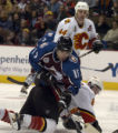 Andrew Brunette (15) goes over the Flames' Jordon Leopold in front of the Flames' net in the third...