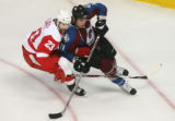 DM0063  Colorado Avalanche Cody McCormick #11, right, and Detroit Red Wings Brad Stuart # 23 cover...