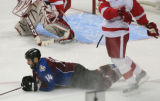 DM0327  Colorado Avalanche Ian Laperriere #14 is knocked down by a Detroit Red Wings in the first...