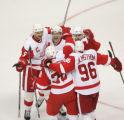 DM0493  Detroit Red Wings celebrate a goal by Pavel Datsyuk #13, center looking up smiling, his...