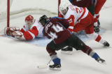 DM0657  Detroit Red Wings Chris Osgood #30 dives to get in front of a shot by Colorado Avalanche...