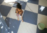 Snoopy the beagle, on the colorful floor that Scotty Walsh painted in the enclosed back porch.  ...