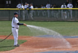 Head coach of UNC, Kevin Smallcomb, does his own field preparation before a game April 25, 2008,...