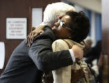 Rhonda Fields mother of Javad Marshall Fields gets a hug from Chief Deputy DA John Hower before...