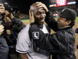ANS153 - Chicago White Sox pitcher Jose Contreras, left, is congratulated by manager Ozzie Guillen...