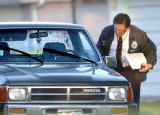 Denver, Colo., photo taken May 30, 2004- City of Denver crime scene homicide investigator, Jon...