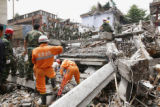 TOK804 - Rescue workers search for earthquake survivors buried under the rubbles of fallen...