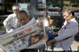 LA103 - A man  reads a Chinese language newspaper Tuesday, May 13, 2008, in the Chinatown section...