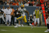 Green Bay's Troy Humphrey (84) runs the ball  in the first quarter as the Denver Broncos play the...