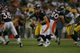 Denver Broncos quarterback Jay Cutler (6) gets ready to hand off the ball in the first quarter as...