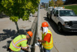 DM0025  Workers put up barricades and fences along the parade route on the Auraria Campus  in...