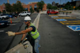 DM0067  Workers put up barricades and fences along the parade route on the Auraria Campus  in...