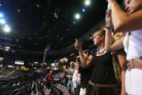 During a public tour of the inside of the Pepsi Center, Elissa Beckman of Denver, in black, and...