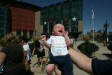 Marc Heirshberg of Highlands Ranch holds up his one-month old son, Keagan Heirshberg outside the...