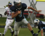 Ralston Valley's QB Liam Felton gains yards in 1st quarter in Arvada, Colo. August 22, 2008. For...