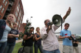 (176) Pro-life protesters get organized near the Pepsi Center as Denver's activity slowly  but...