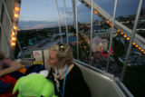 UPI videographer Kristin Volk from DC rides high up at a Celebration with Altitude a party for DNC...