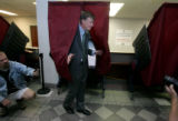 Mayor John Hickenlooper votes during early voting at the Denver Election Commission on Tuesday...