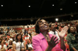 Chaplin P.K. Roberts sings, prays and claps during the DNC interfaith service held Sunday, August...