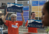 Pat Nelson (cq), left and Darren Geary (cq), welcome people to DIA, Sunday morning, August 24,...