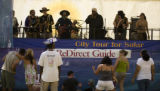 People listen to the band US Pipe at the Solar Stage during the Green Frontier Festival at the...