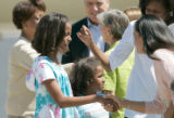 BG_0134  Malia Obama, 10, left, and her sister Sasha Obama, 7, are greeted by a welcome committee...
