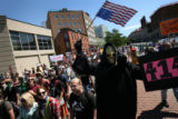 War protesters march to the Pepsi Center before the Democratic National Convention on Sunday,...