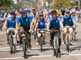Caption:  Power to the Pedal!  Denver Mayor John Hickenlooper (second from right) joins with...