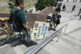 Raphael Shay walks down the steps behind police officers to the 16th Street Mall in Denver on...