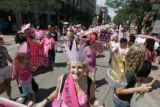 Protest group Code Pink marches down the 16th Street Mall in Denver as police units move them off...