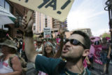 Raphael Shay marches with Protest group Code Pink marches down the 16th Street Mall in Denver as...