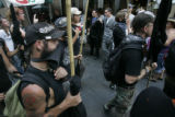 Protesters on the 16th Street Mall in Denver for the Democratic National Convention on Sunday,...