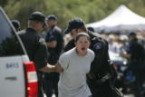Destinie Maynes is arrested by police during a protest at Colfax and Broadway Sunday afternoon in...